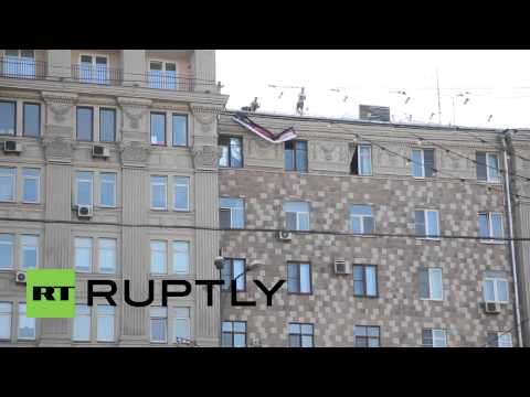 Russia: 'I don't tell the truth' Obama banner at US embassy