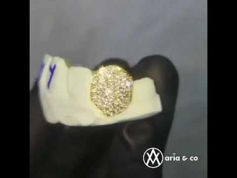 Watching video Bustdown fangz done by aria & co jewelry