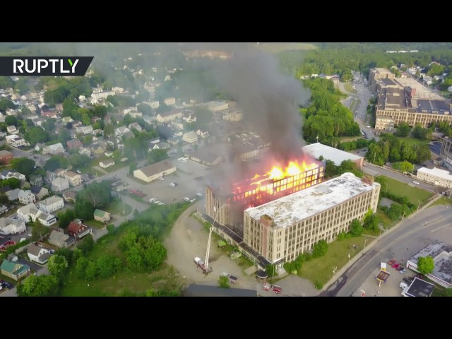 Massive fire tears through old mill in US, more than 100 firefighters battle flames (AERIAL VIDEO)