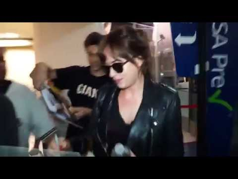 September 20th, 2014 - Dakota Johnson arrives at LAX Airport in Los Angeles