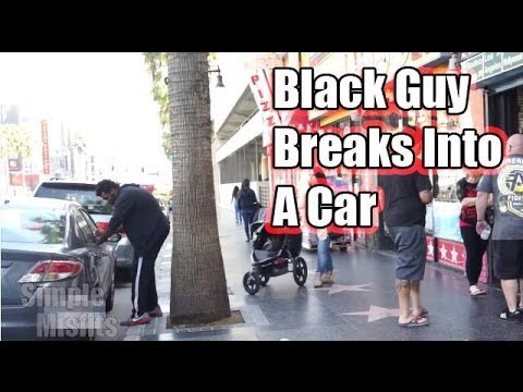 Black Guy Breaks Into A Car video