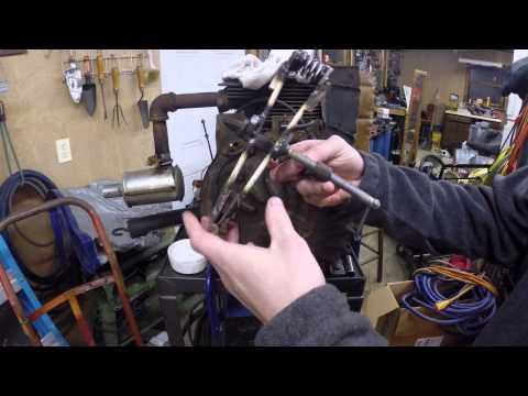 Homemade valve spring compressor for a small engine