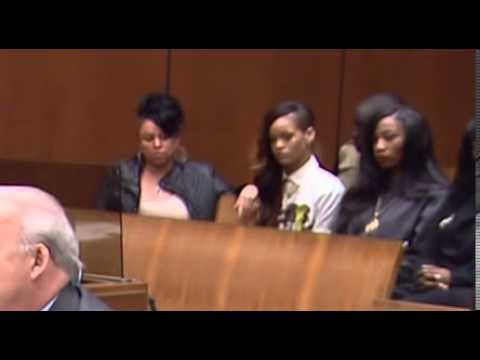 Inside court  Rihanna reacts as Chris Brown listens to the judge