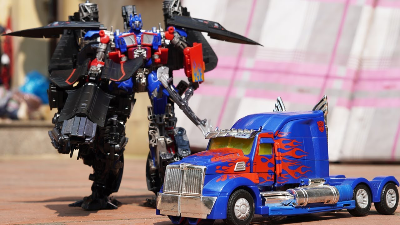 STOP MOTION TRANSFORMERS - Optimus Prime Jetfire combine IRL & Hole Animation Movie Robot TOYS