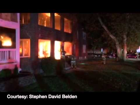 Student runs inside burning apartment to wake tenants
