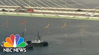 Watch As Greenpeace Protesters Suspend Themselves From Busy Houston Bridge | NBC News