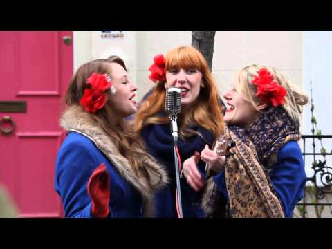 Street singers Sugar Sisters perform at Portobello Road in London