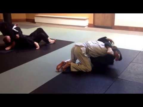 BJJ flow drills in teen martial arts class. Image 1