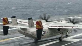 Search continues for missing sailors after Navy plane crash
