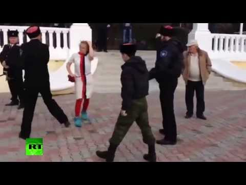 Pussy Riot whipped by Cossack in Sochi performance fail