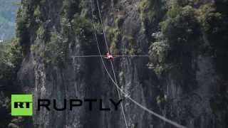 Drone captures stunning tightrope walk across gorge in China