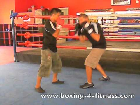 Basic boxing defense drills with partner Image 1