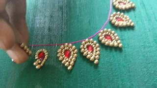 Variety Neck Embroidery Design for a Saree Blouse