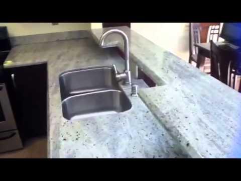 Instalacion terminada de granito youtube - Como cortar marmol encimera ...