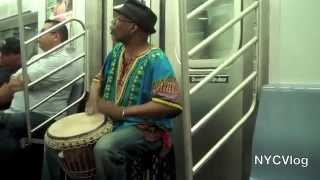 African Drummer Performing on NYC Subway Train - Subway Musician NY