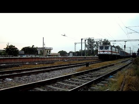 Er King Turns 45 : Loud Honking Wap-7 Howrah Rajdhani Scorches Past Wair At A Thunderous Pace ...!! video