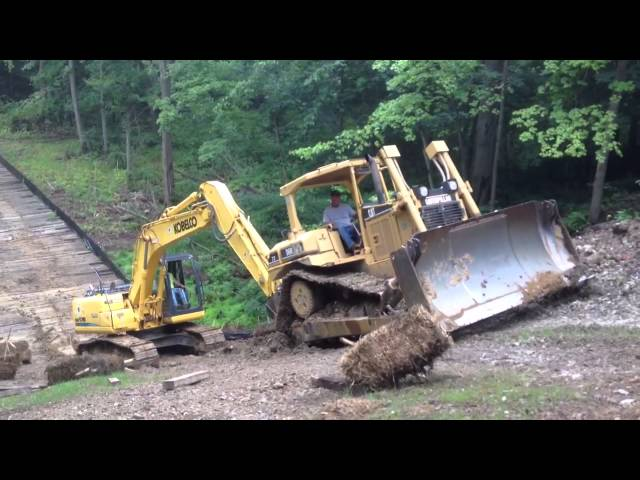 Steep slippery slope for a dozer and excavator