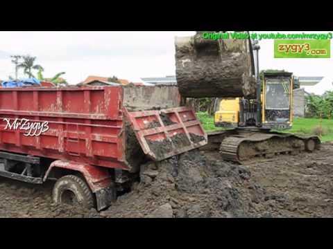 Excavator Volvo EC210B Helping Out 2 Stuck Dump Truck