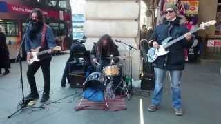 U2, With Or Without You cover - busking in the streets of London, UK
