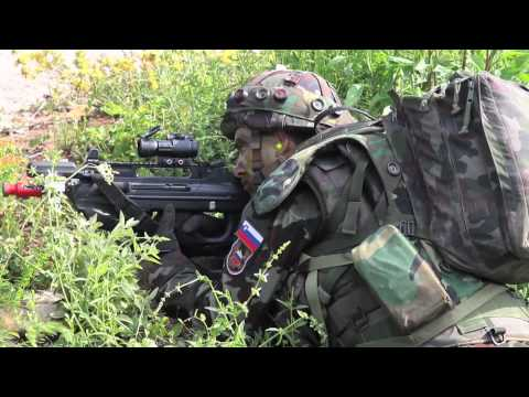 Slovenian soldiers with FN F2000 rifles conduct assault training