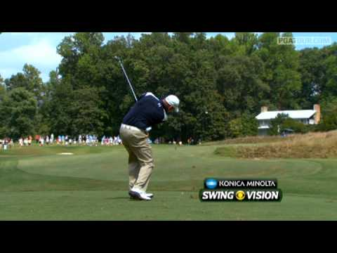 In the third round of the 2011 Wyndham Championship, Tommy Gainey hits his approach to 18 feet on the par-4 6th hole and rolls in the birdie putt.