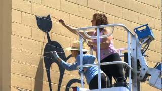 Tricia George and Agnes paint the Cat's Cradle mural