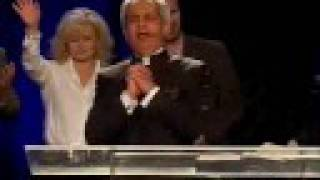 Benny Hinn sings more