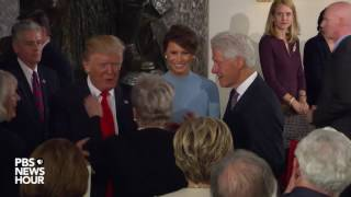 President Donald Trump enters Statuary Hall luncheon