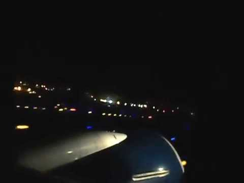 Delta Air Lines taking off at night at Los Angeles International Airport