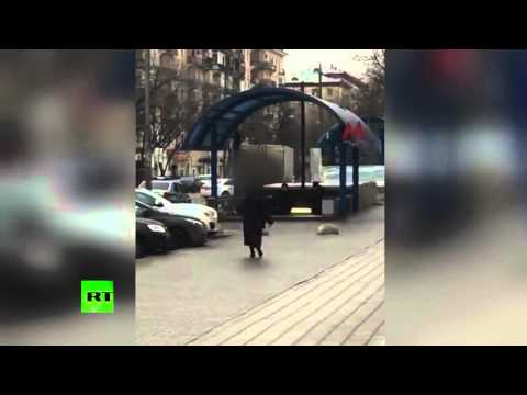 GRAPHIC: Woman waves 'child's head', screams 'I am terrorist' outside Moscow Metro