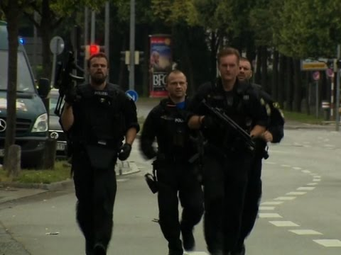 Raw: Police Clear Munich Streets After Shootings