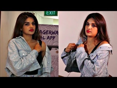Nidhhi Agerwal CAUGHT ON CAMERA Adjusting Dress At An Event