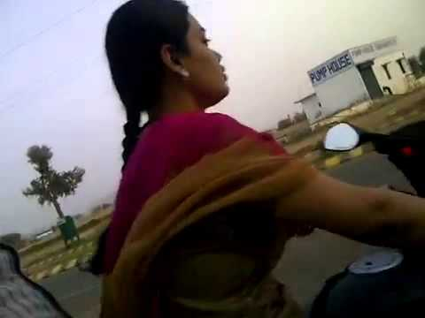 Sexy Indian Girl Riding Pulsar 220 video