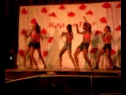 a group of teen age girls dancing their winning piece in an amateur dance ...