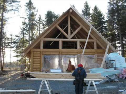 Maison en bois rond youtube for Maison en bois ronde