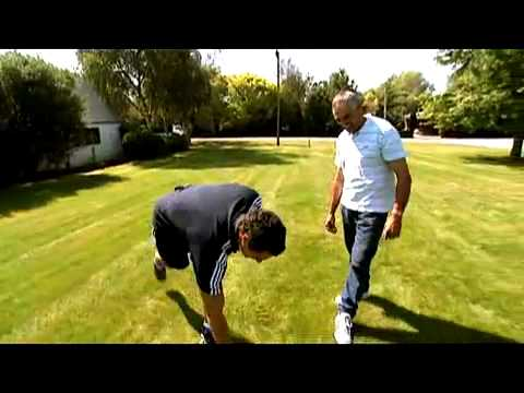 Dan Carter practising his kicking at home with his dad.