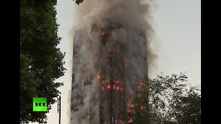 Person trapped in burning Grenfell tower block in west London