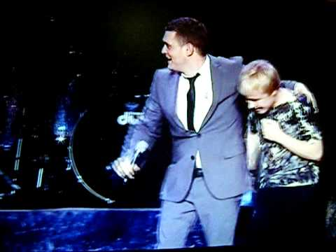 Sam Hollyman on stage with Michael Buble