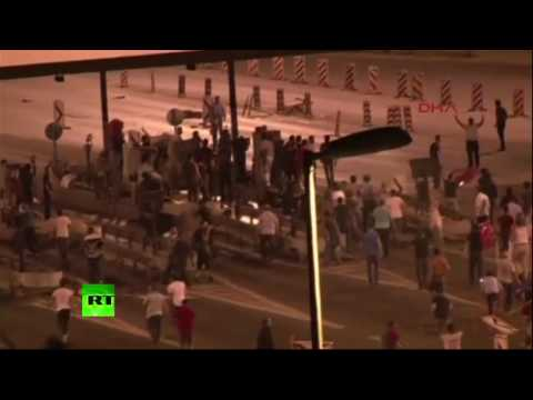 Istanbul citizens lie and stand blocking the way for military vehicles