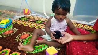 1 year 4months baby playing stacking game perfectly
