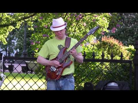 An Amazing Street Musician Plays the Electric Guitar