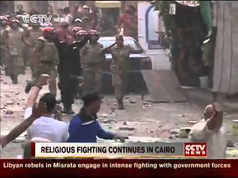Hundreds of Christians and Muslims clash in Cairo