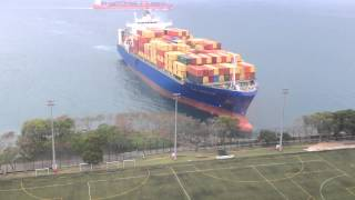 Container ship sails straight to shore by university football field