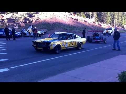 Matt Saunders' Pikes Peak video blog: Ralf Christensson's front-running 1967 Ford Mustang GT 350 launches off the line SUBSCRIBE to Autocar: http://youtube.c...