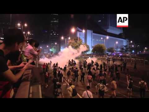 Tear gas fired into crowd and police barriers destroyed in pro-democracy protest