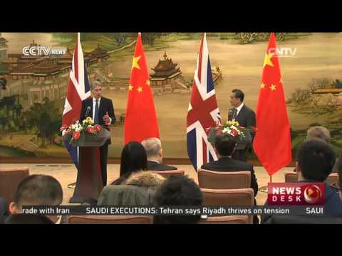 Wang Yi meets UK counterpart Philip Hammond