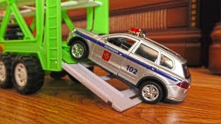 Transportation Vehicles Loading and Moving Police Toy Cars to a different location