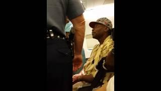 Woman getting arrested on landidng-flight AA406