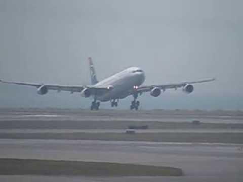 SA A340 landing @ Hong Kong Chek Lap Kok airport slow motion - Canon SX50 HS