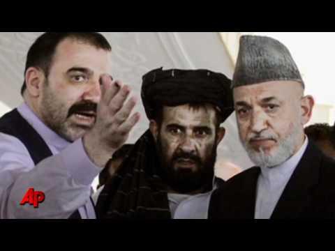 Afghan President Buries Slain Half Brother